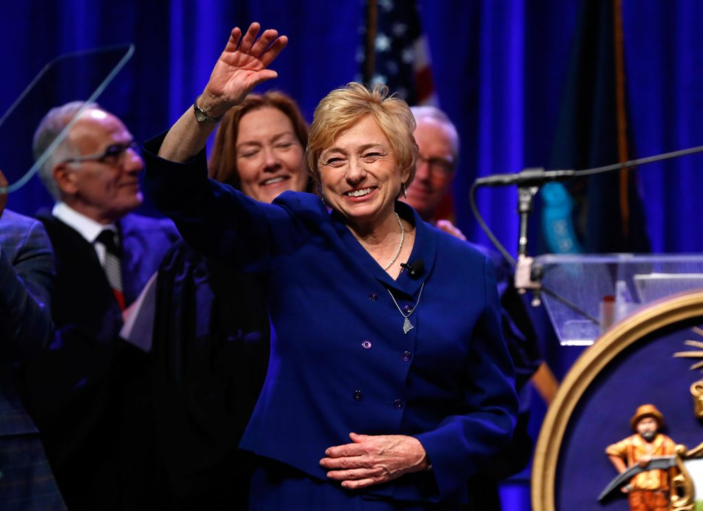 Gov. Janet Mills acknowledges applause after taking the oath of office Wednesday. Mills, a Democrat, is the state's first woman to serve as governor.