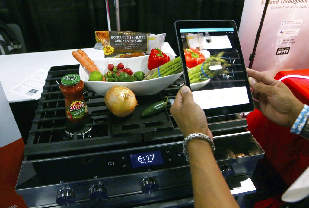 Whirlpool Corporation and Yummly team up to create smart cooking appliances through a series of over the air updates to both product software and the Whirlpool and Yummly Guided Cooking brand apps, at the CES Unveiled at CES International Sunday, Jan. 6, in Las Vegas.