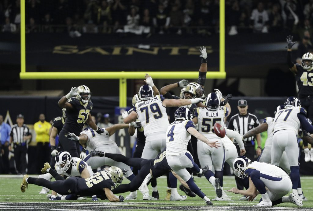 Los Angeles Rams kicker Greg Zuerlein kicks the game-winning field goal in overtime in the NFC championship game against the New Orleans Saints on Sunday in New Orleans. The Rams won 26-23.