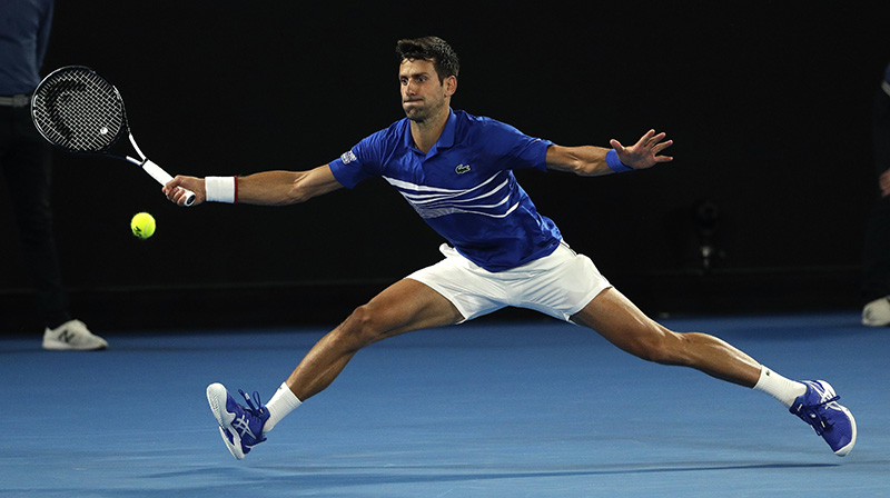 Novak Djokovic makes a forehand return to Lucas Pouille during their semifinal match at the Australian Open tennis championships in Melbourne on Friday.