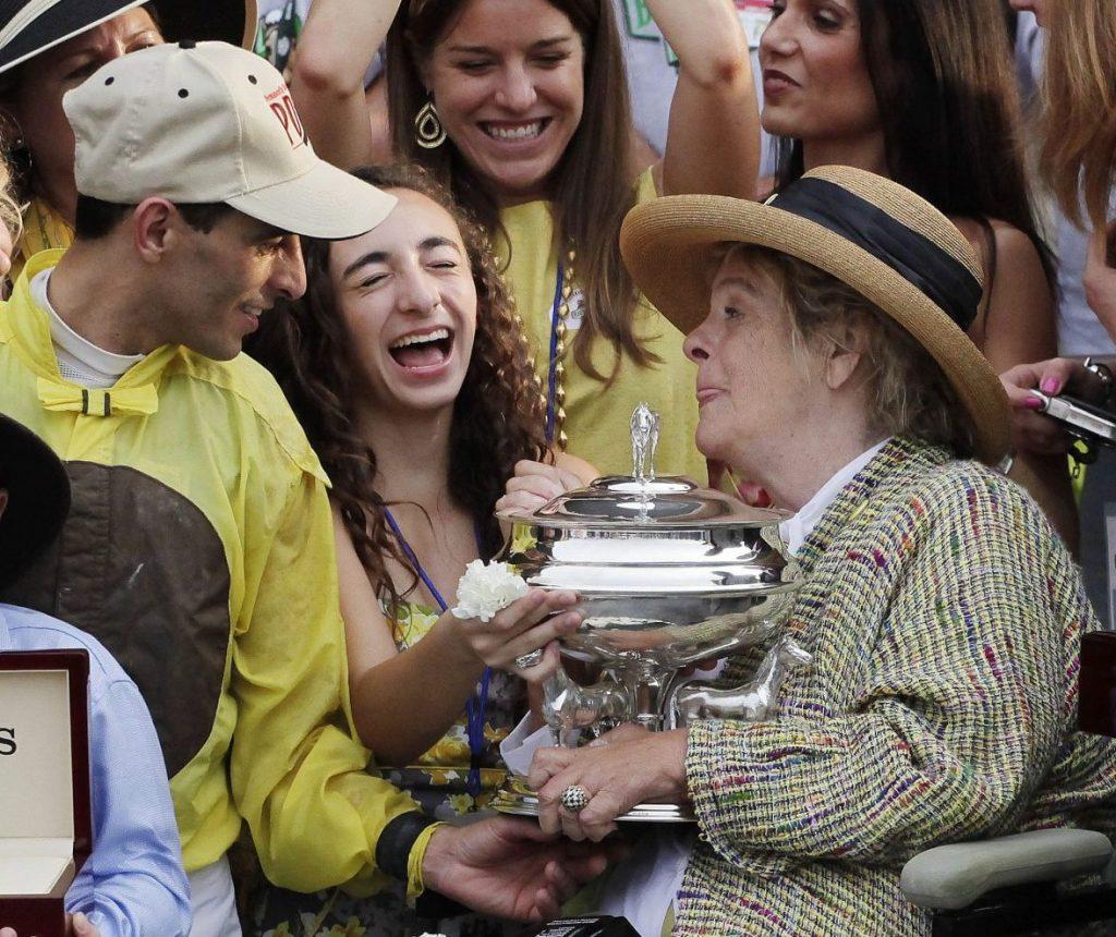 Phyllis Mills Wyeth, right, celebrates with jockey John Velasquez and supporters after her horse, Union Rags, won the Belmont Stakes on June 9, 2012, at Belmont Park in Elmont, N.Y.  Wyeth, who with her husband, Jamie, was a longtime Maine arts philanthropist, died Monday at age 78.