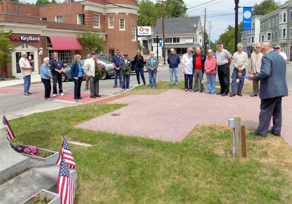 KeyBank will close its Wilton branch office and other branches in Bethel, Guilford and Winthrop on April 19. The Wilton bank is shown in the background during the Memorial Day service in May 2018.