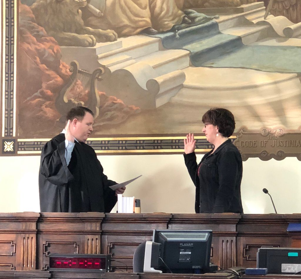 Cherri Crockett of Bethel is sworn in as the Oxford County register of deeds by Oxford County Probate Judge Jared Crockett on Dec. 31, 2018, at the Oxford County Courthouse in Paris.