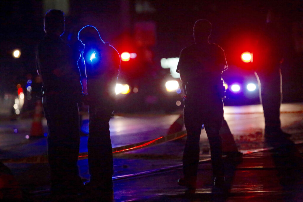 Investigators work at the scene of the shooting Wednesday night in Falcon Heights, Minn. Leila Navidi/Star Tribune via AP