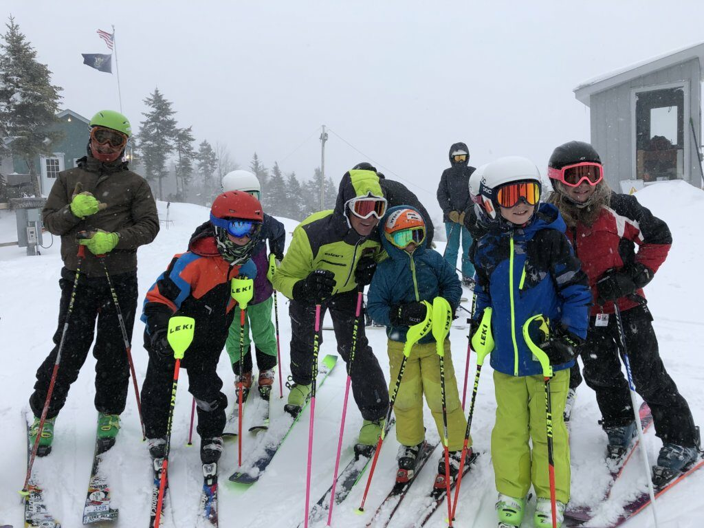 Extreme skier Glen Plake and his wife, Kimberly, pose with children at Black Mountain of Maine in Rumford on Jan. 19.