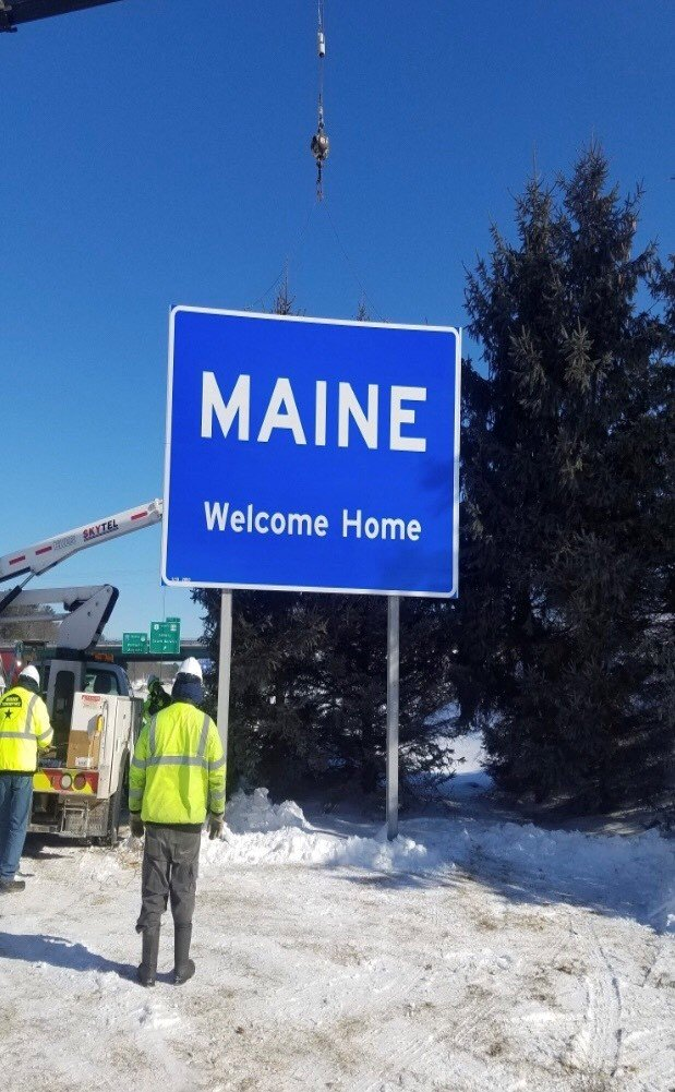 """The Maine Turnpike Authority has installed a new """"Welcome Home"""" sign near the state's border with New Hampshire. It replaces the sign that read """"Open for Business."""""""