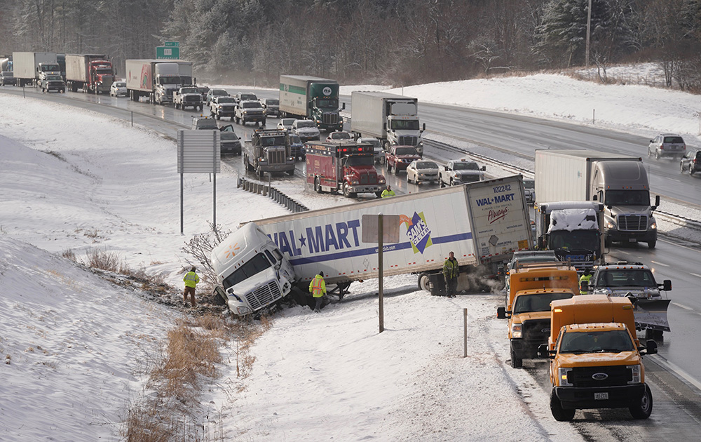 Traffic backs up as it is routed around a jackknifed tractor trailer truck in the northbound lane of the Maine Turnpike near mile marker 33 in Biddeford on Thursday morning.