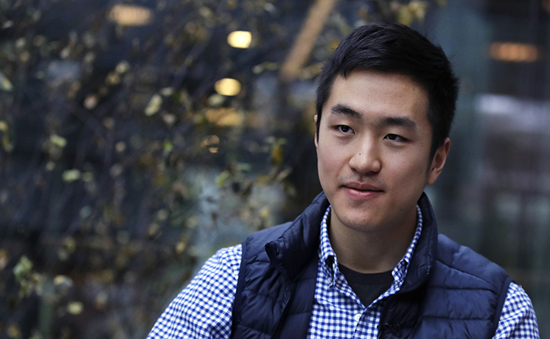 Harvard University graduate Jin K. Park, who holds a degree in molecular and cellular biology photographed in Cambridge, Mass. in December.
