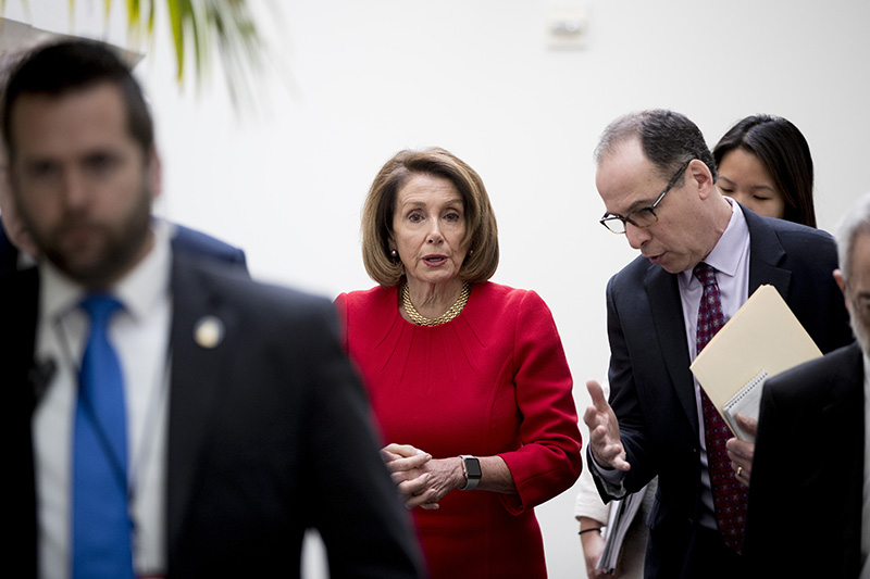 House Speaker Nancy Pelosi of Calif. leaves a House Democratic Caucus meeting on Capitol Hill on Wednesday.