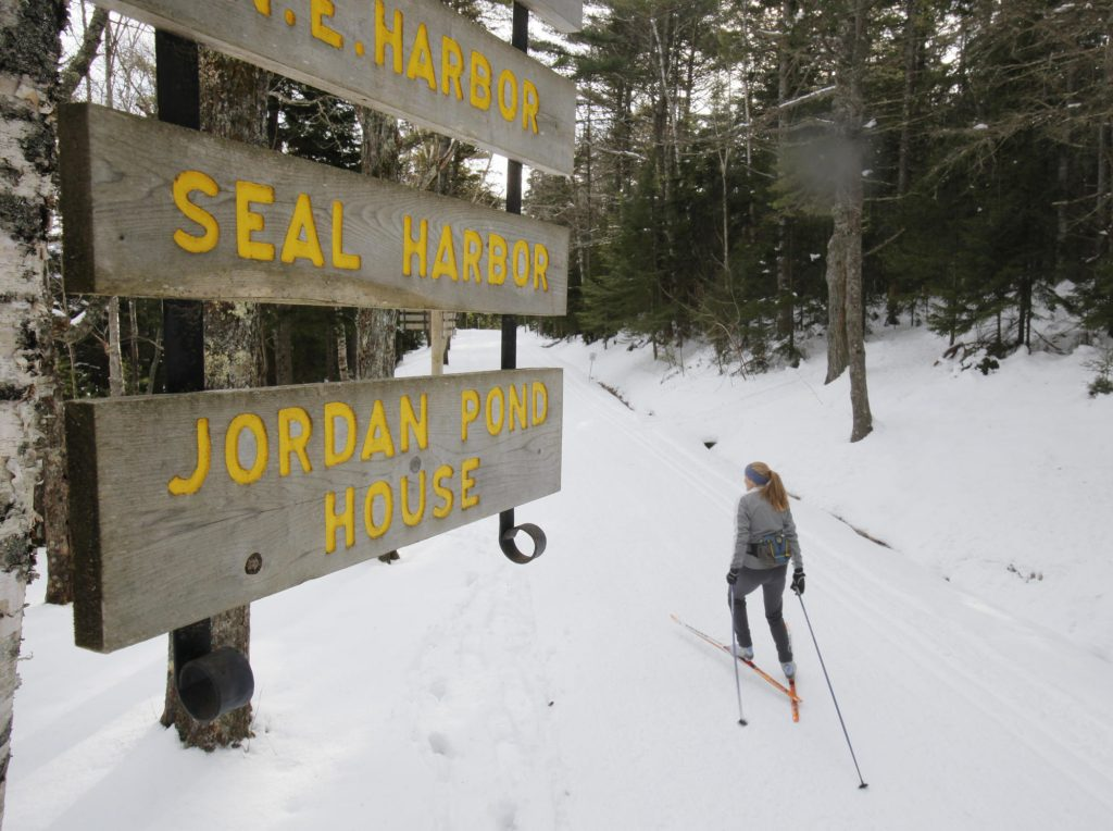 In this January 2010 photo, Abigail Curliss of Southwest Harbor skis alongside Eagle Lake on a carriage road in Acadia National Park.