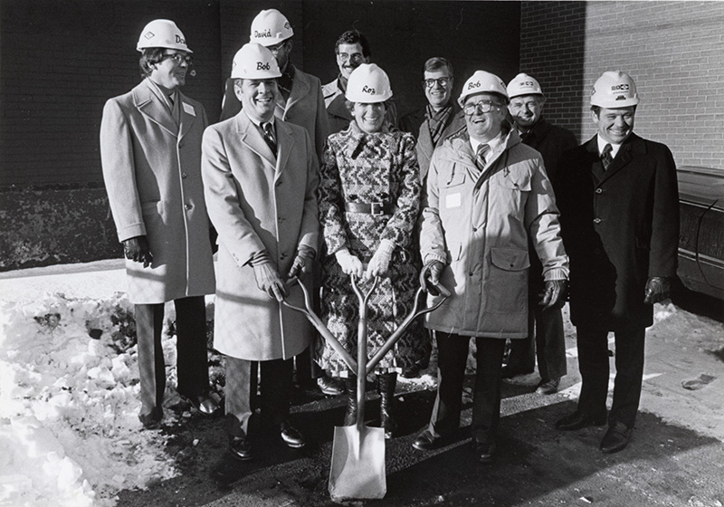 Rosalyne Bernstein stands in front holding a shovel at the groundbreaking for the Portland Museum of Art's Payson building, which opened in 1983.