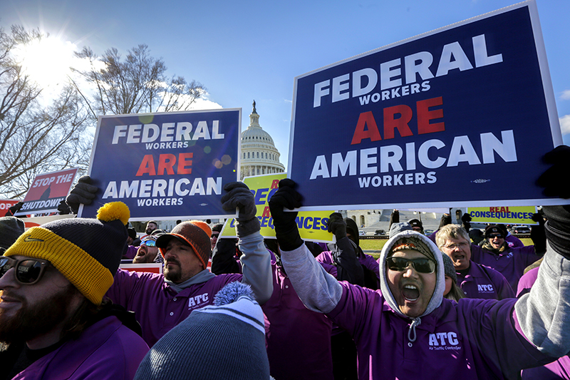 On the 20th day of a partial government shutdown, federal employees rally at the Capitol to protest the impasse between Congress and President Donald Trump.