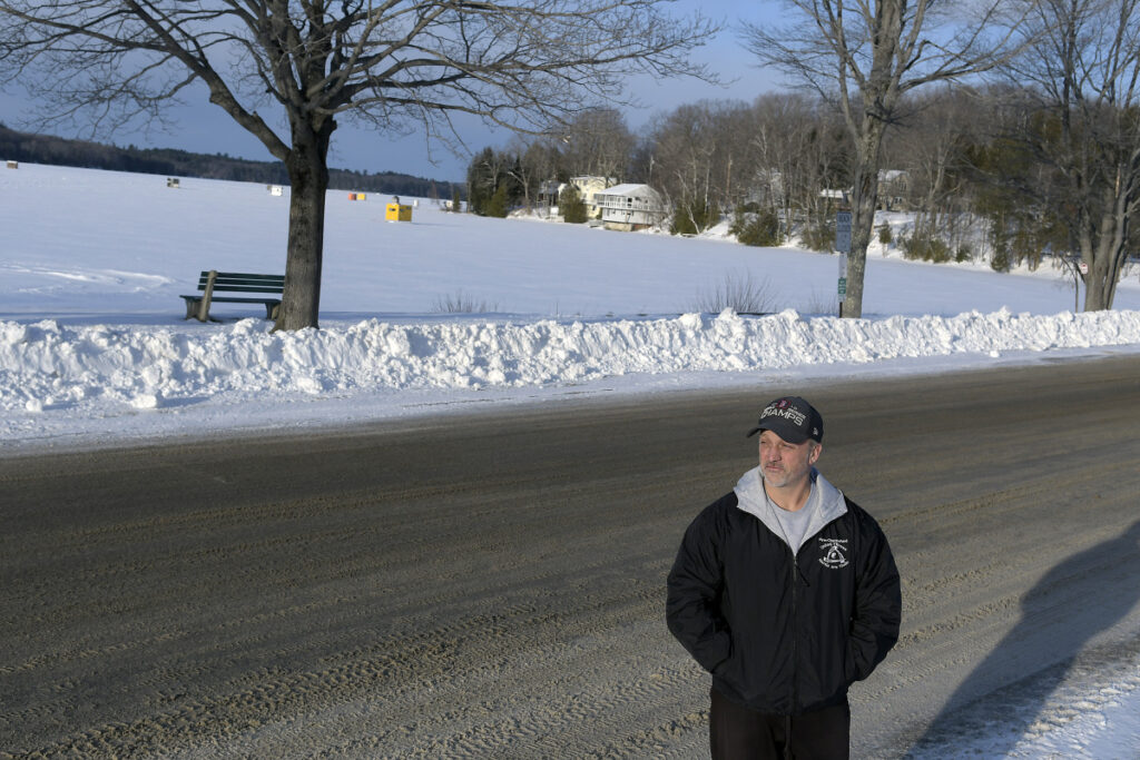 Ryan Chamberland stands near his home Thursday on Memorial Drive in Winthrop. He said the road along Maranacook Lake is deteriorating and the town is not maintaining it properly.