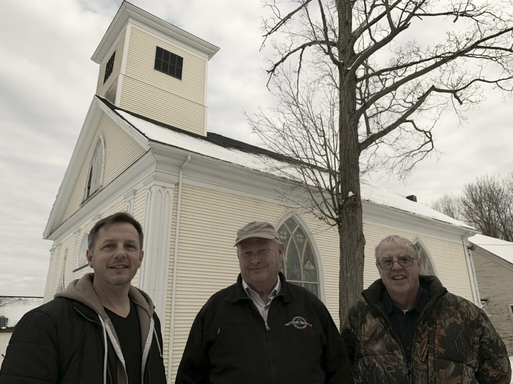 From left, pastor Ramsey Tripp, of Life Community Church, stands in front of the congregation's newly acquired church building in Gardiner with Dan Bailey and Dan McGrath, of the First Baptist Church of Gardiner, the seller. The churches plan to schedule services at different times to maximize shared use of their parking lots.