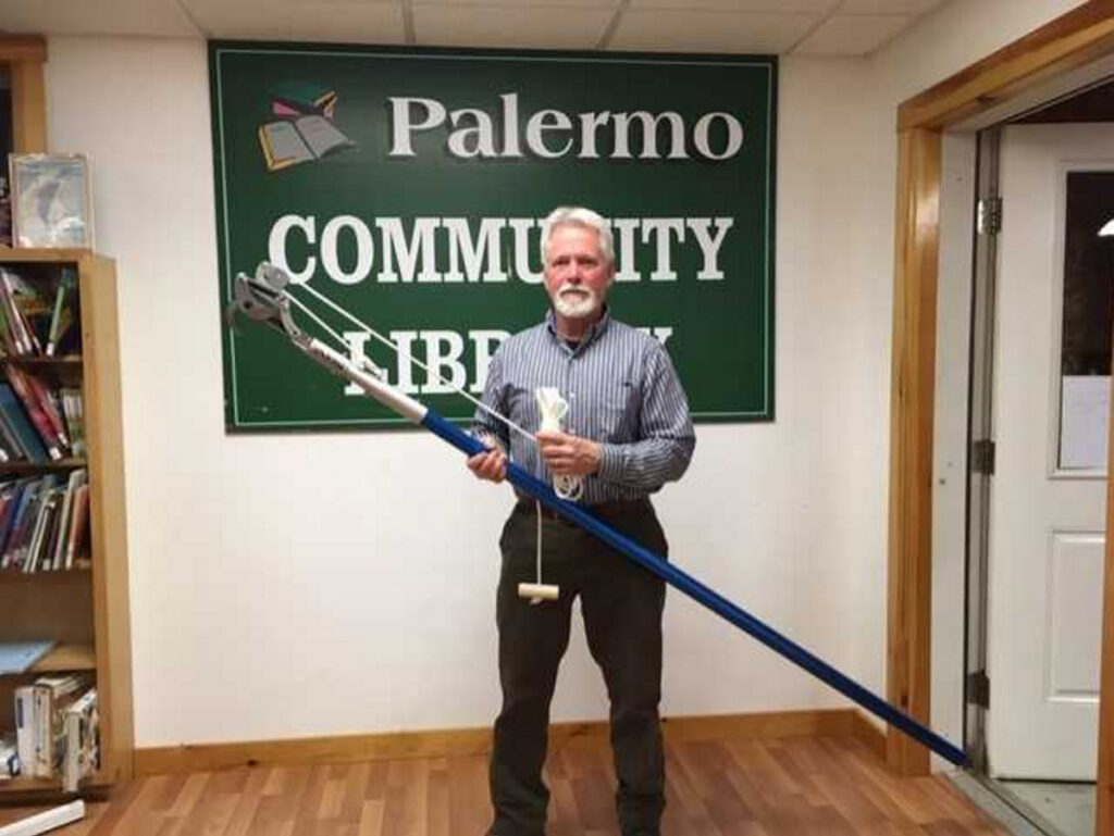 Don Salvatore with the new pole pruner that is available for patrons to borrow to prune any brown tail moth winter webs from their trees.