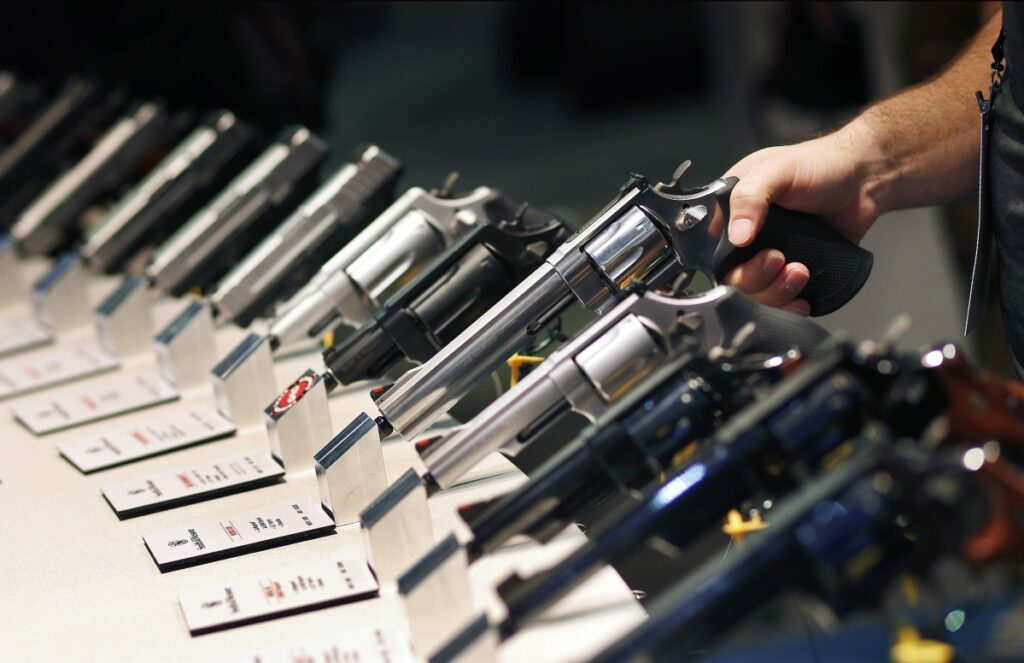 Handguns are displayed at the Smith and Wesson booth at the Shooting, Hunting and Outdoor Trade Show in Las Vegas in 2016.