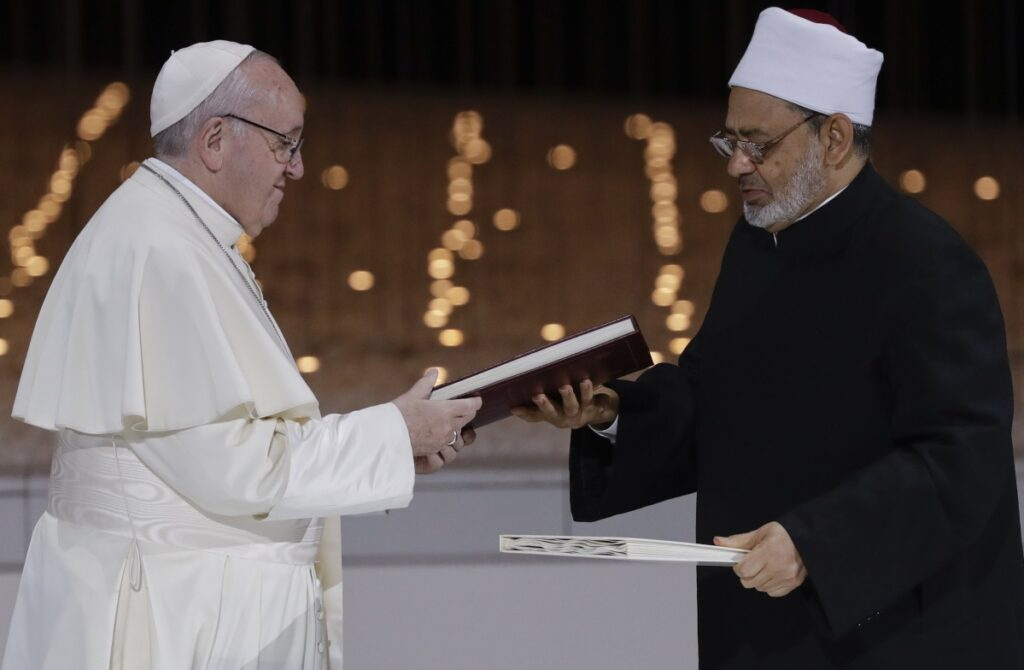 "Pope Francis and Sheikh Ahmed el-Tayeb, the grand imam of Egypt's Al-Azhar, exchange a joint statement on ""human fraternity"" after an interfaith meeting at the Founders' Memorial in Abu Dhabi, United Arab Emirates, Monday."