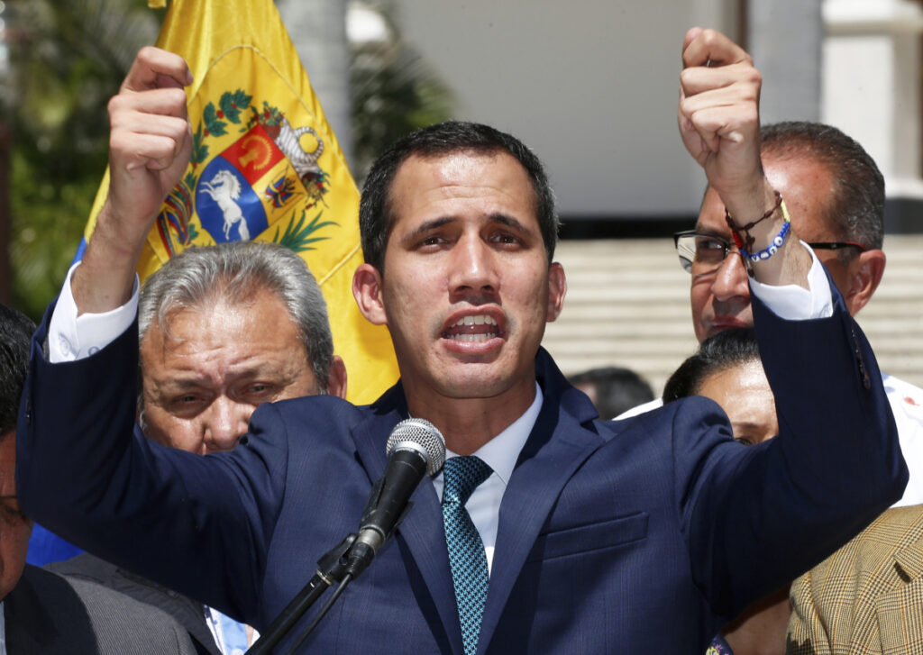 Opposition leader Juan Guaido, who has declared himself the interim president of Venezuela, speaks during a press conference Monday on the steps of the National Assembly in Caracas. He thanked European governments for their support.
