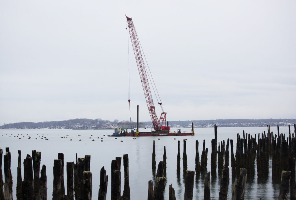 Fore Points Marina is expected to open this spring and is the first phase of the former Portland Co. complex project on the city's eastern waterfront. Above, workers have been on the water since November setting anchor blocks for the floating docks.