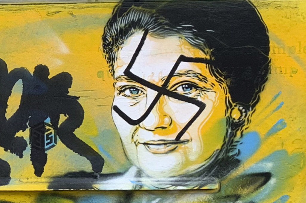 A swastika covers the face of late Holocaust survivor and French politician Simone Veil on a mailbox in Paris on Monday. Mairie du XIIIth via AP