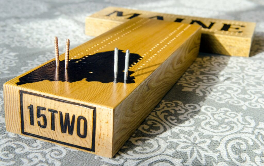 William Terry wood-burns his handmade cribbage boards with the 15TWO brand name Feb. 2 in Richmond.
