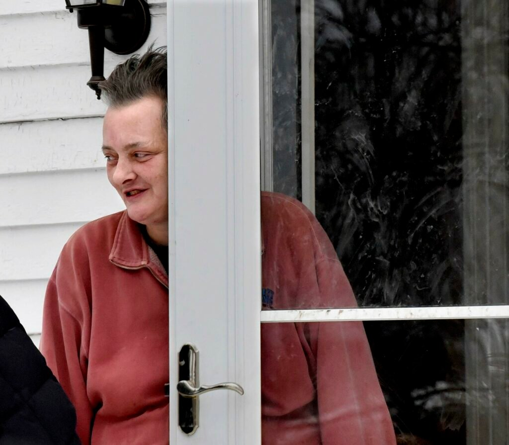 Pet owner Laura Plourde speaks on Thursday about the dogs and cats police and state animal welfare agents removed from her home on Wednesday.