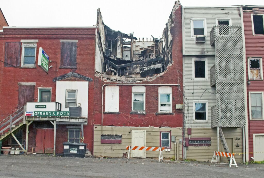 The collapsed roof of the building at 235 Water St. in Gardiner, as it looked on Oct. 22, 2015. The building was heavily damaged by a fire earlier that year.