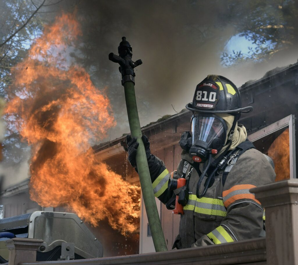 A firefighter rolls off the deck of a home that burned Tuesday on Keith Drive in Chelsea. Firefighters from several departments went to the blaze, which destroyed the residence, according to firefighters, but no injuries were reported.