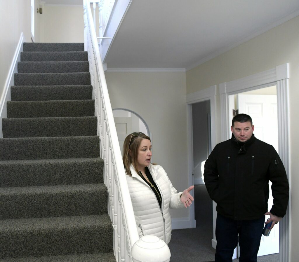 Jennifer and Brian Wood, the CEO and CFO respectively of Blue Willow Counseling, in the lobby Sunday of the building the firm plans to purchase at 103 Winthrop St. in Augusta.