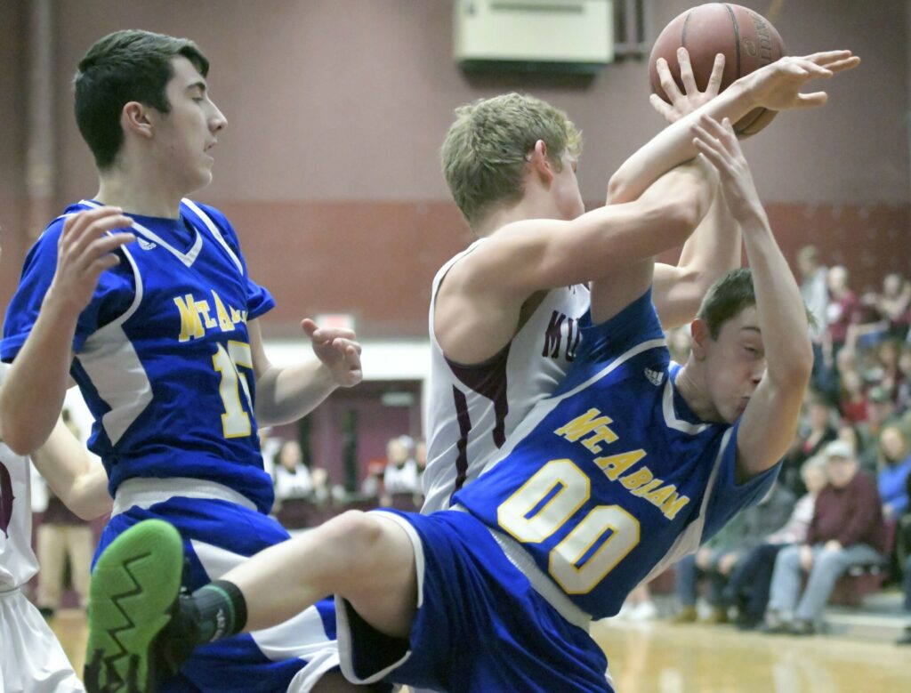 Monmouth Academy's Evan Burnell flips Mt. Abram's Hunter Warren during a game Thursday in Monmouth.