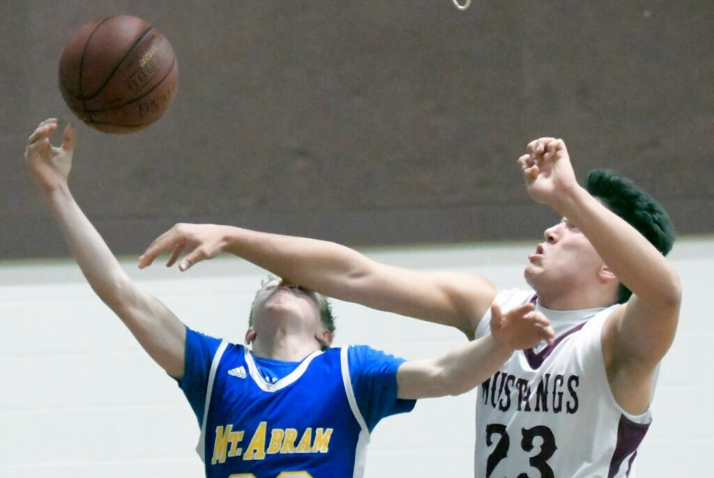 Monmouth Academy's Brock Bates denies Mt. Abram's Hunter Warren a shot during a game Thursday in Monmouth.