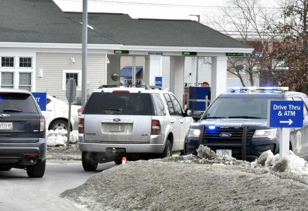 Three police vehicles block the entrance to the Bangor Savings Bank on Waterville Commons Drive on Feb. 12 after a robbery there. The robbery suspect, Jason Mackenrodt, 37, was sentenced Thursday to five years in prison for the crime.