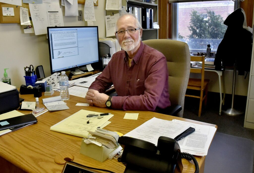 "Randy Gray, shown Tuesday in his office in Skowhegan, has been the town's code enforcement officer for nearly 40 years and will retire this June. Gray said he has enjoyed his many years of working and will miss his staff, which he described as ""the best."""