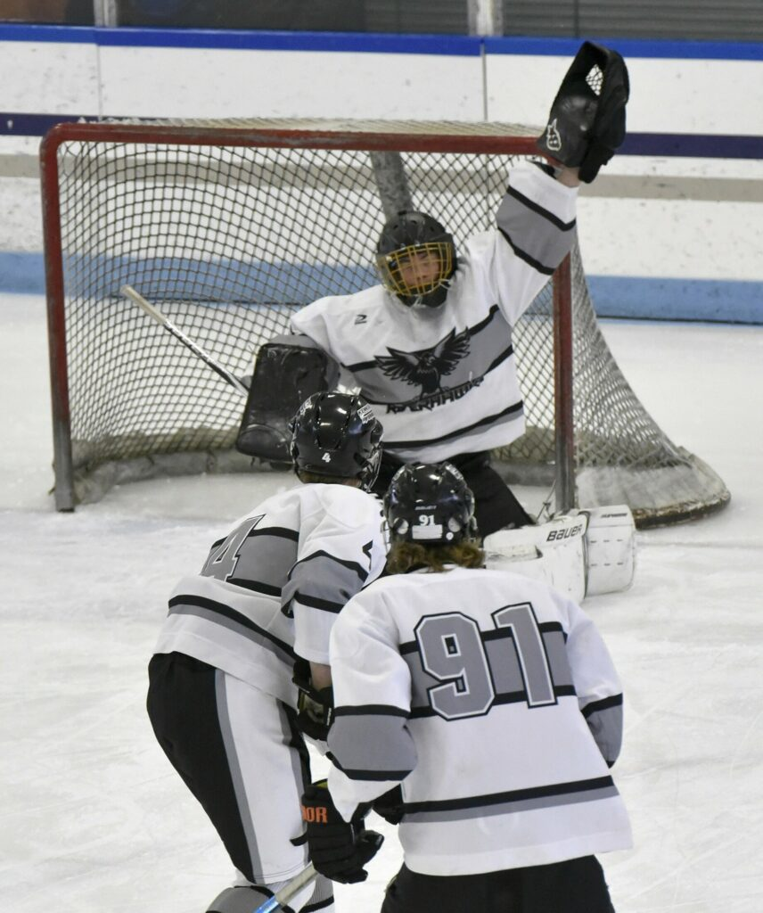 Kennebec goalie Ben Grenier reaches high for a save during a Class B North game against Orono/Old Town on Tuesday in Waterville.