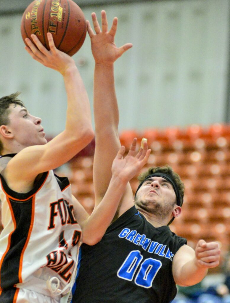 Forest Hills'  Parker Desjardins, left, gets fouled by Greenville defender Nicholas Calazzo during a Class D south semifinal game Wednesday at the Augusta Civic Center.