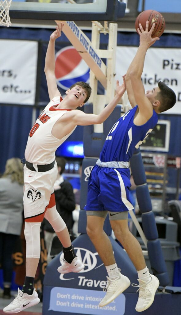 Cony's Luke Briggs can't collect a rebound from Lawrence's Jacob Patterson during a Class A North semifinal Wednesday in Augusta.