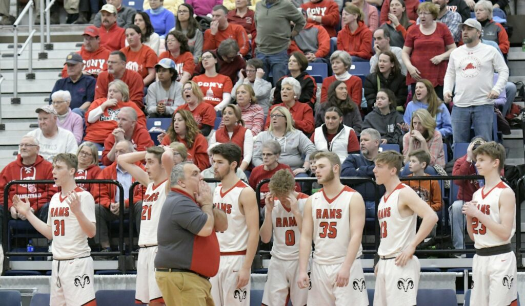 Cony High School's bench and fans react to the last moments of a tournament basketball game against Lawrence High School on Wednesday at the Augusta Civic Center.