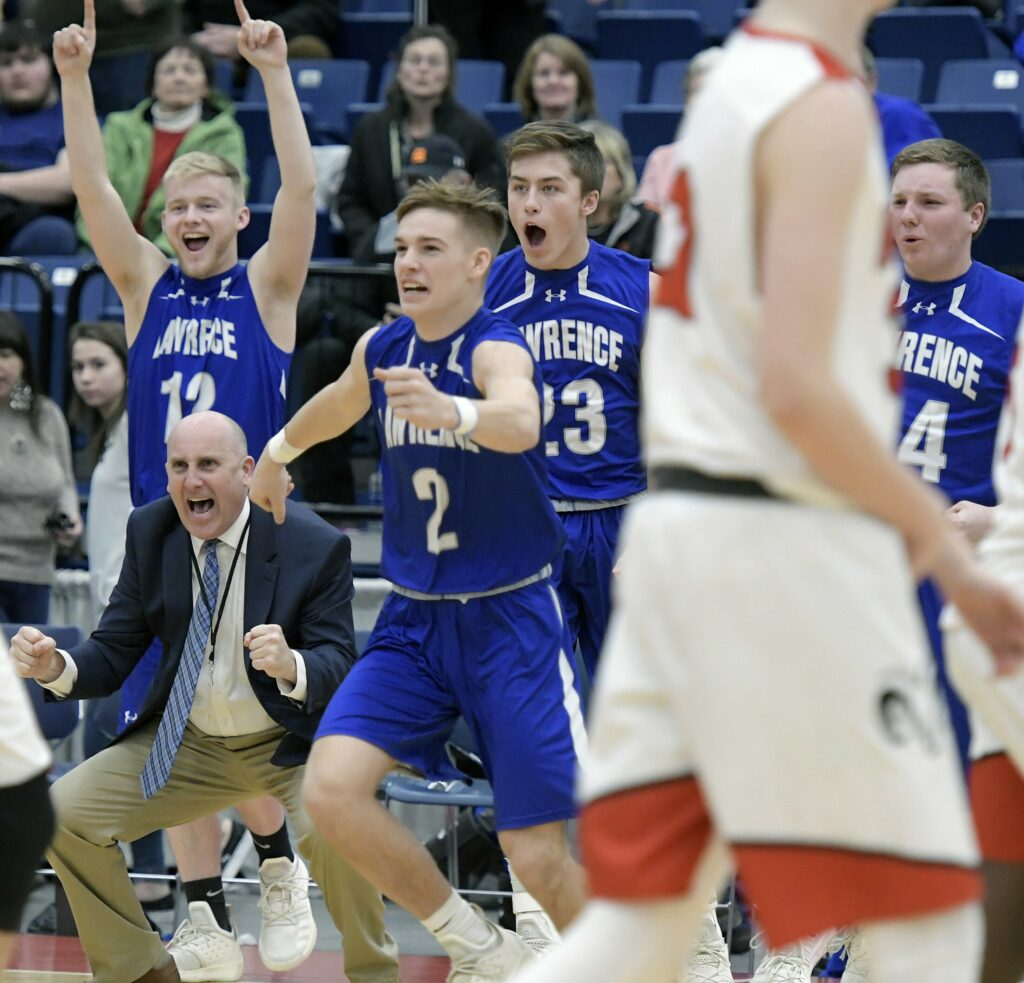 Lawrence High School's bench erupts after defeating Cony High School during a tournament basketball game on Wednesday at the Augusta Civic Center.
