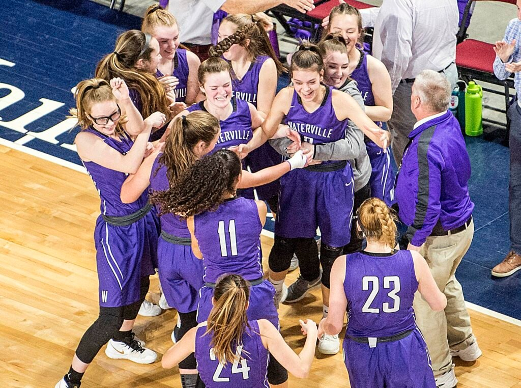 f3187cf54e7 The Waterville girls basketball team stands for the national anthem before  playing Hermon in a Class B North semifinal game Wednesday at the Cross  Insurance ...