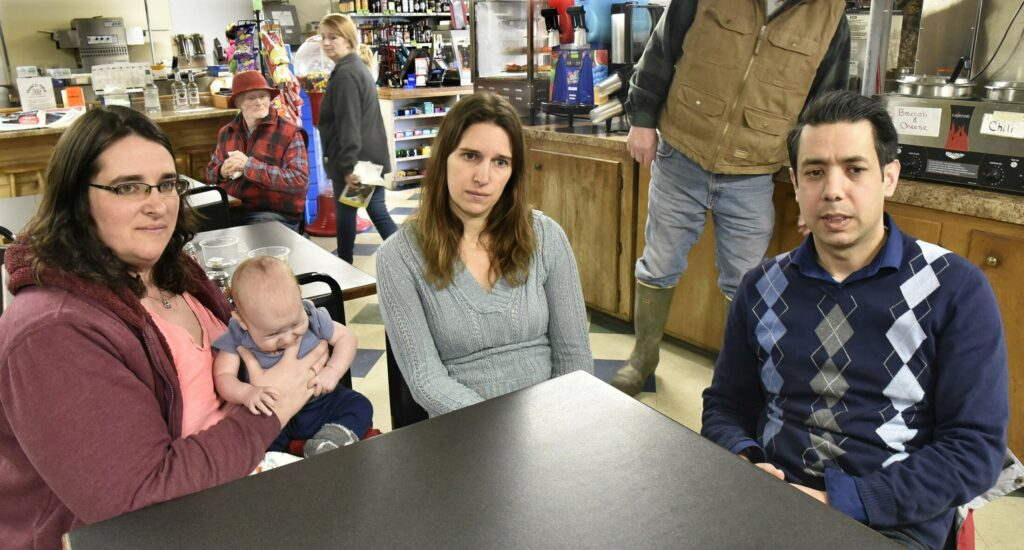 Former Athens Corner Store owners Katie Anton, with son Matthew, and Stephanie Miller sit with current store manager Alex Rehman on Tuesday and discuss the recent sale of the town landmark.
