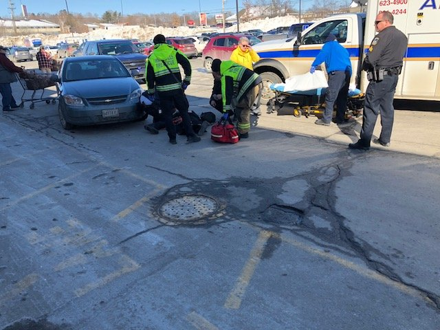 An older woman was struck by a car in Elm Plaza off upper Main Street in Waterville on Tuesday. The driver of the car that struck the woman said she was blinded by the sun.