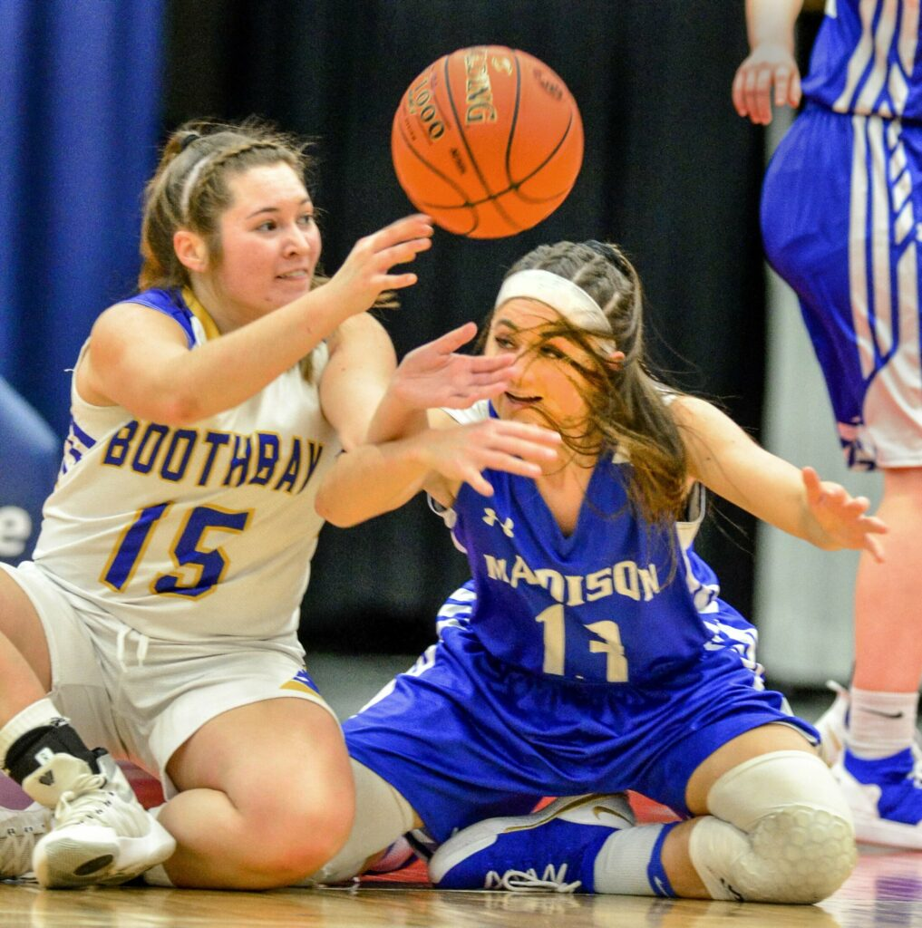 Boothbay's Madison Faulkingham, left, and Madison's Emily Edgerly go after a loose ball during a Class C South semifinal game last season at the Augusta Civic Center.