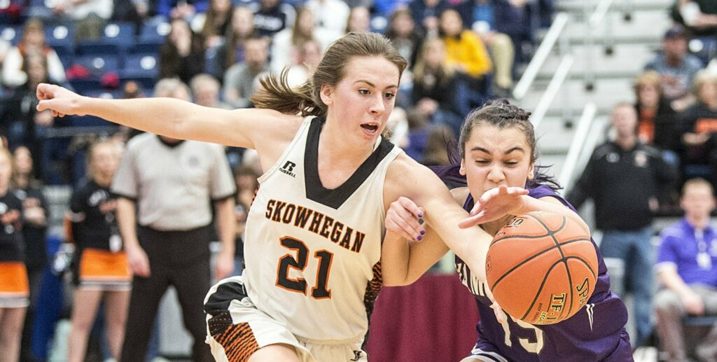 Skowhegan senior Annie Cooke goes for a loose ball with Hampden's Alydia Brilliant during the Class A North championship game at the Augusta Civic Center.