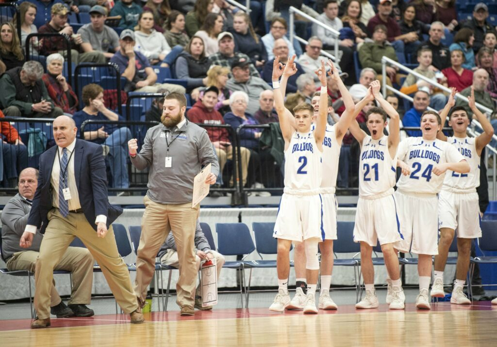 The Lawrence High School bench celebrates a 3-pointer during the Class A North championship game against Skowhegan last Friday night at the Augusta Civic Center.