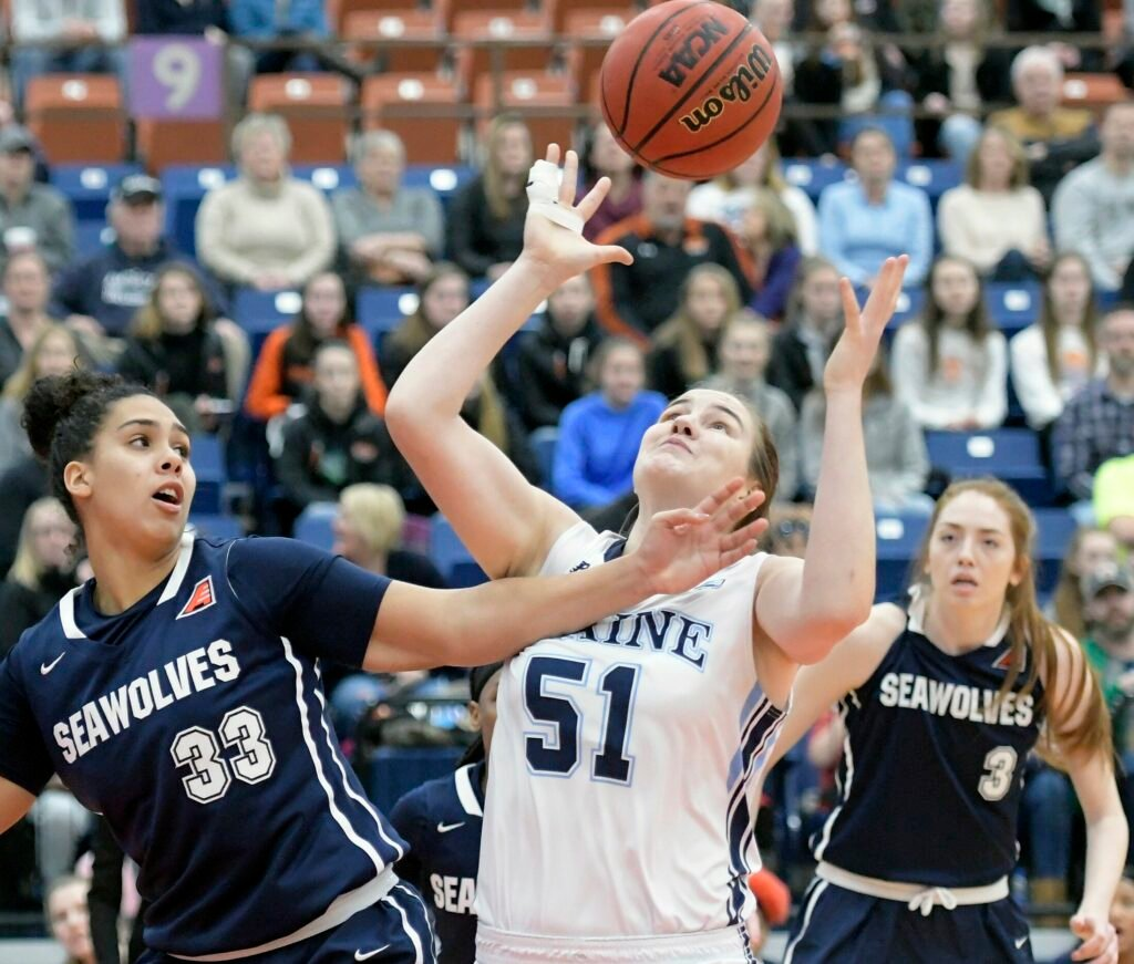 The University of Maine's Fanny Wadling collects a rebound from State University of New York at Stony Brook's India Pagan during a basketball game Sunday at the Augusta Civic Center.