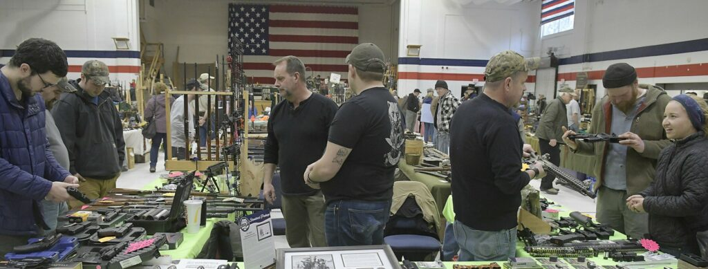 Guests browse Sunday among firearms and supplies at the Ancient Ones show in Augusta.