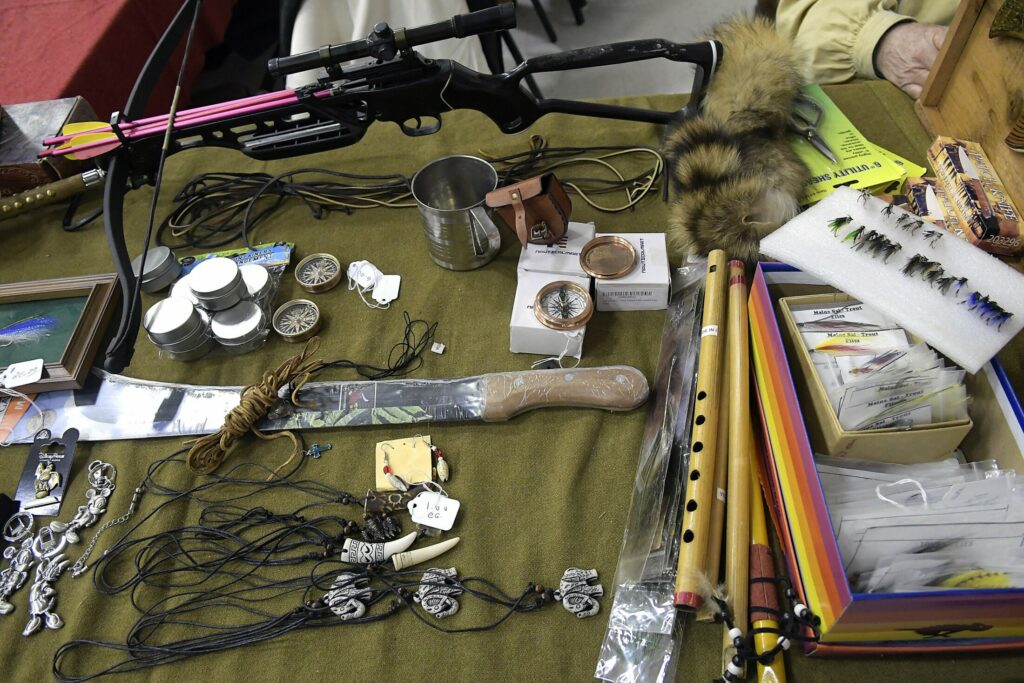 Items for sale on Sunday at the Ancient Ones show in Augusta included guns, flies, compasses and crossbows.