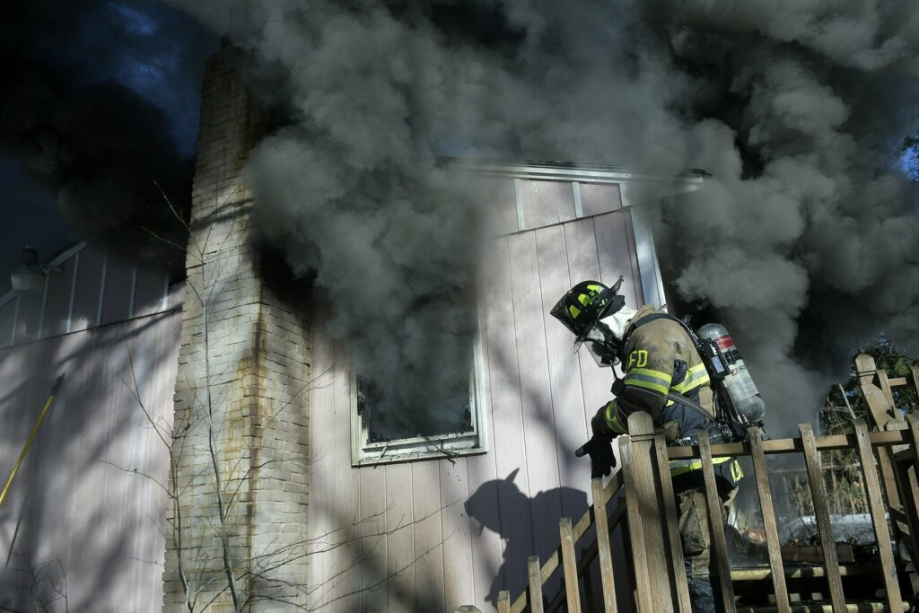 A firefighter exits a home that burned Tuesday on Keith Drive in Chelsea. Firefighters from several departments went to the blaze, which destroyed the residence, according to firefighters, but no injuries were reported.