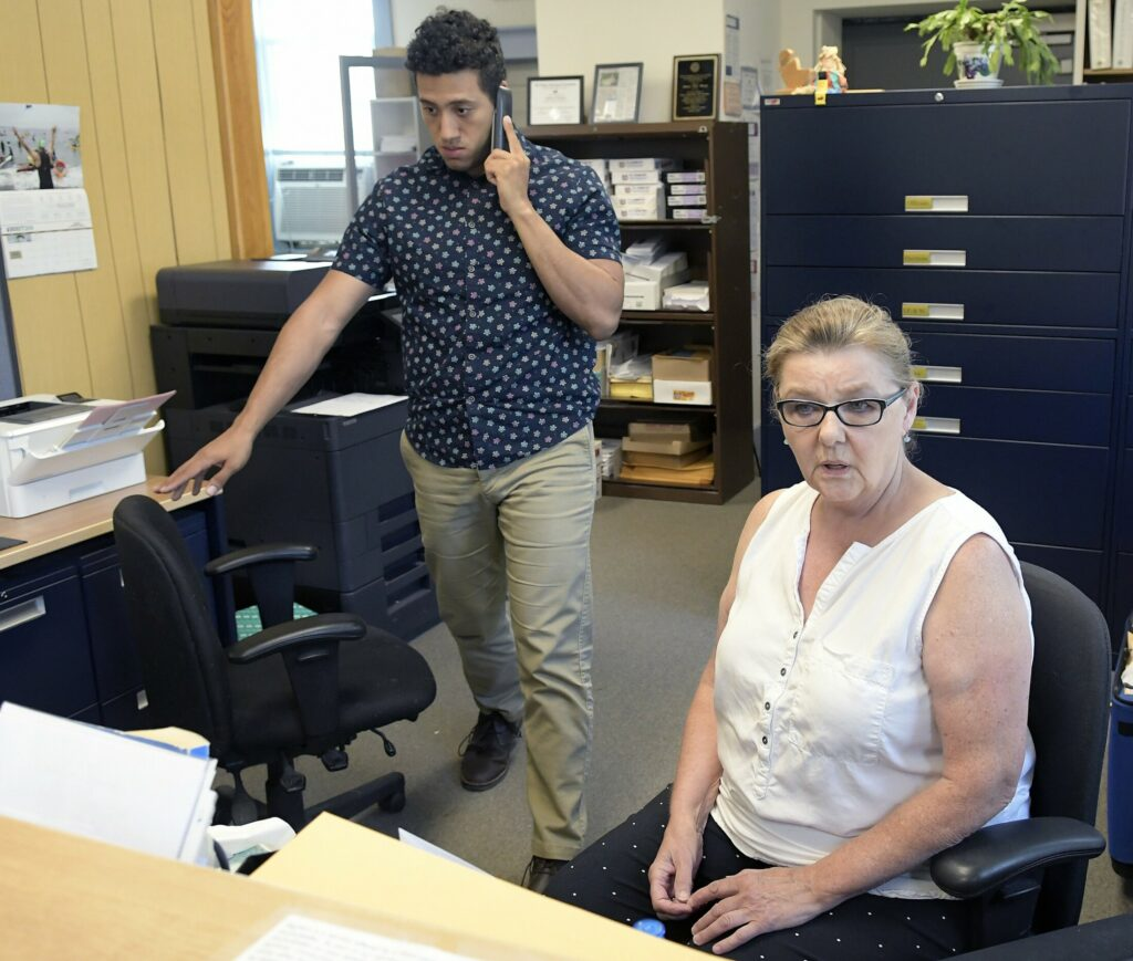 Dresden Clerk and Treasurer Shirley Storkson and administrative assistant Michael Henderson work at the Dresden Town Hall on Aug. 21, 2018.