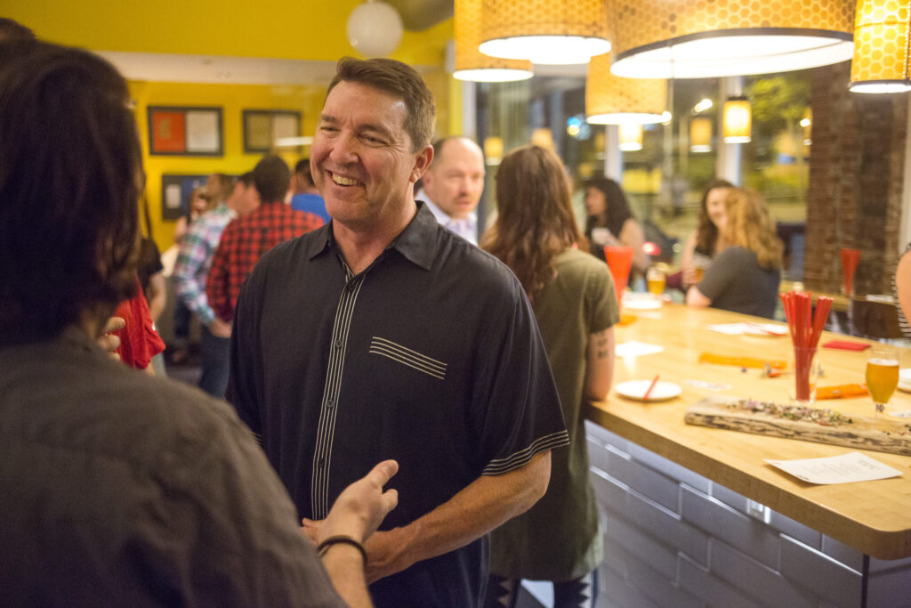 "Matt Jacobson, executive director of the Maine Lobster Marketing Collaborative, talks with San Francisco restaurant owner Stuart Brioza at the ""Maine After Midnight"" event at the downtown Portland restaurant The Honey Paw on June 12."
